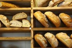 Italian bread on wooden shelves. Italian bread exposed on wooden shelves Royalty Free Stock Image