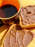 Italian breakfast 2. Close-up of a cup of coffee and two rusks with chocolate cream Royalty Free Stock Photo