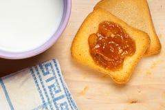 Italian breakfast. Typical italian breackfast: Jam, crispbread and a cup of good milk Stock Photo