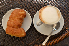 Italian breakfast. With cappuccino and cornetto Royalty Free Stock Image