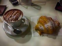 Italian breakfast. Cappuccino and croissant Stock Image