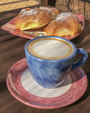 Italian breakfast. Cappuccino and croissant. Royalty Free Stock Image