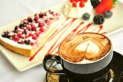 Italian breakfast with cappuccino and fruit cake Stock Image