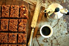 Italian breakfast with chocolate cake and coffee on a vintage board