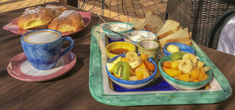 Italian breakfast. Fruit, honey, yogurt, slices of bread, butter. royalty free stock photos