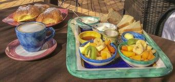 Italian breakfast. Fruit, honey, yogurt, slices of bread, butter. Royalty Free Stock Photos