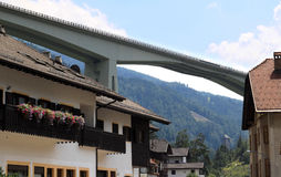 Italian Brenner Autobahn through little village Stock Photo