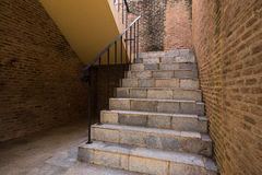 Italian brick stairway and handrail with brickwall Royalty Free Stock Photo