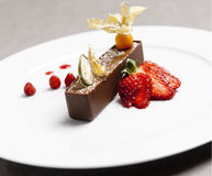 Italian brown chocolate dessert with strawberry red. Italian brown chocolate dessert with strawberry Royalty Free Stock Photography