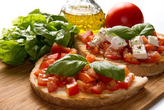 Italian bruschetta. With fresh tomatoes, basil, garlic, olive oil and cheese Stock Image