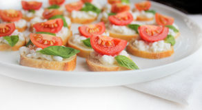 Italian bruschetta with cherry tomato,basil and ch Royalty Free Stock Images