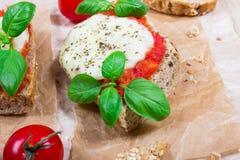 Italian bruschetta with cherry tomatoes, mozzarella & fresh basil. Royalty Free Stock Photography