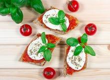 Italian bruschetta with cherry tomatoes, mozzarella & fresh basil. Royalty Free Stock Image
