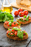 Italian bruschetta with chopped vegetables, herbs and oil on gr Stock Photography