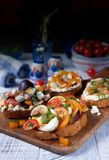 Italian bruschetta on dark wood stock image