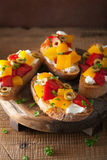 Italian bruschetta with peppers goat cheese olives Royalty Free Stock Photo