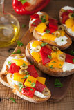 Italian bruschetta with roasted peppers goat cheese olives Royalty Free Stock Image