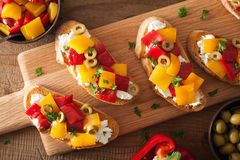 Italian bruschetta with roasted peppers goat cheese olives Royalty Free Stock Photography