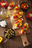 Italian bruschetta with roasted peppers goat cheese olives Royalty Free Stock Photo