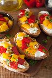 Italian bruschetta with roasted peppers goat cheese olives Stock Image