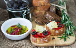 Italian bruschetta. With roasted peppers, olives, artichokes and olive oil Stock Image