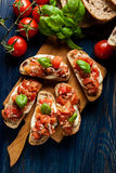 Italian bruschetta with roasted tomatoes, mozzarella cheese and Stock Photo