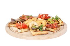 Italian bruschetta and taralli over cutting board Stock Image