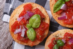 Italian bruschetta with tomato, onion and basil Stock Images