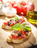 Italian Bruschetta with tomatoes. Italian appetizer Royalty Free Stock Photo