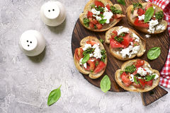 Italian bruschetta with tomatoes,feta and basil pesto .Top view. Stock Image