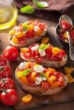 Italian bruschetta with tomatoes garlic olive oil Stock Photography