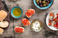 Italian bruschetta with tomatoes and goat cheese on wooden table Stock Image