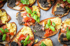 Italian bruschetta. With tomatoes, olive paste on a serving plate Royalty Free Stock Images