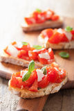 Italian bruschetta with tomatoes, parmesan, garlic and olive oil Royalty Free Stock Photo