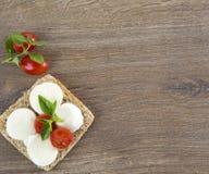 Italian bruschetta. On wood background Royalty Free Stock Images