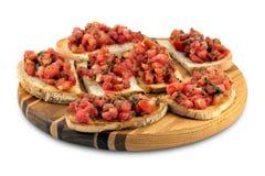 Italian bruschetta on a wooden cutting board Royalty Free Stock Photos
