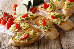 Italian bruschetta with zucchini and tomatoes close-up and ingre Royalty Free Stock Photo