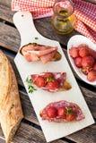 Italian bruschettas with ham prosciutto, coppa and salami Stock Image