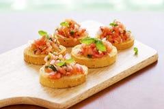 Italian Bruschette. Italian bruschetta with tomato and basil Royalty Free Stock Photography