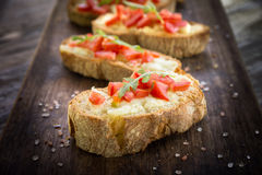 Italian bruschette, traditional appetizers Stock Photos