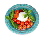 Italian buffalo mozzarella cheese with cherry tomatoes and basil Stock Photography
