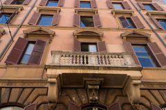 Italian building facade. Beautiful view to italian style building facade. Picture is in warm colors Royalty Free Stock Image
