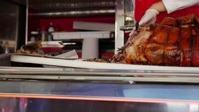 Italian butcher slices porchetta pork roast stock video footage