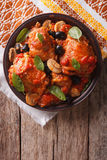Italian Cacciatori chicken on a plate . vertical top view Stock Images
