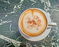 Italian caffelatte cup on green marble table Royalty Free Stock Photos