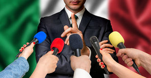 Italian candidate speaks to reporters - journalism concept Stock Photos