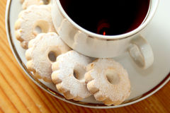 Italian Canestrelli cookies on the saucer of a cup of black tea Royalty Free Stock Photos