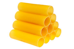 Italian cannelloni pasta. Italian cannelloni pasta tubes in pile isolated over white background Royalty Free Stock Images