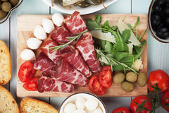 Italian capicola, cured pork meat. Slices of italian capicola, cured and aged pork meat Royalty Free Stock Images