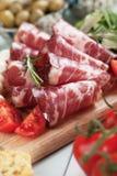 Italian capocollo, cured pork meat. Sliced italian capocollo, cured and aged pork meat Royalty Free Stock Photos